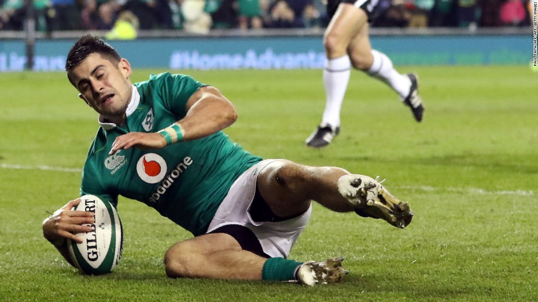 Ireland's full-back Tiernan O'Halloran scores his team's third try during the contest with Canada.