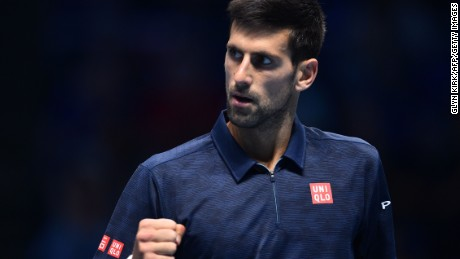 Serbia's Novak Djokovic celebrates a point against Austria's Dominic Thiem on his way to victory in his ATP World Tour Finals opener.