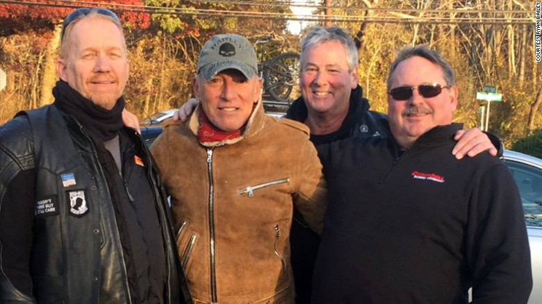 Bob Grigs, Dan Barkalow and Ryan Bailey (from left) of the Freehold American Legion - Monmouth Post 54 pose with Bruce Springsteen.