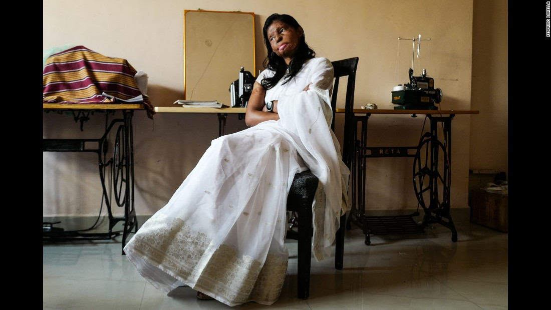 Rupa wears a traditional sari as she poses for a portrait at home. She owns a little boutique inside the Sheroes cafe where she sells her own handmade clothing.