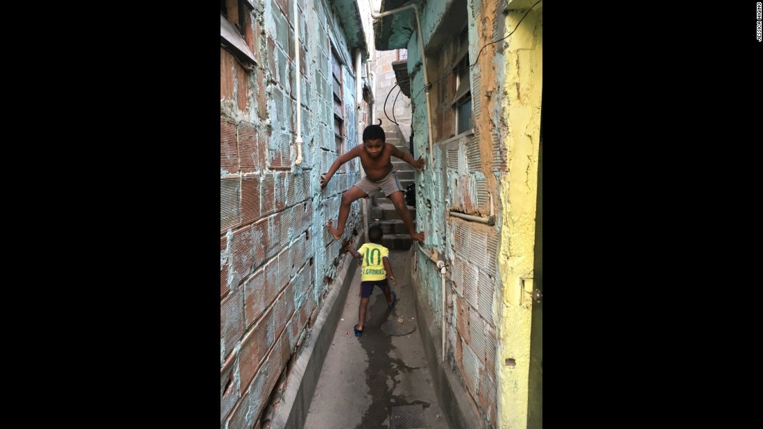 "Higino said she tried to capture every element of her slum, from the cold buildings to the children playing through the alleys. <br /><br />""I show a bit of everything with my photos. I did not want to hide anything because I wanted people to really learn about my community,"" she said."