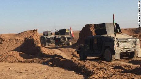 Armored Humvees from Salahuddin regiment cross the defensive berm heading towards eastern Mosul.