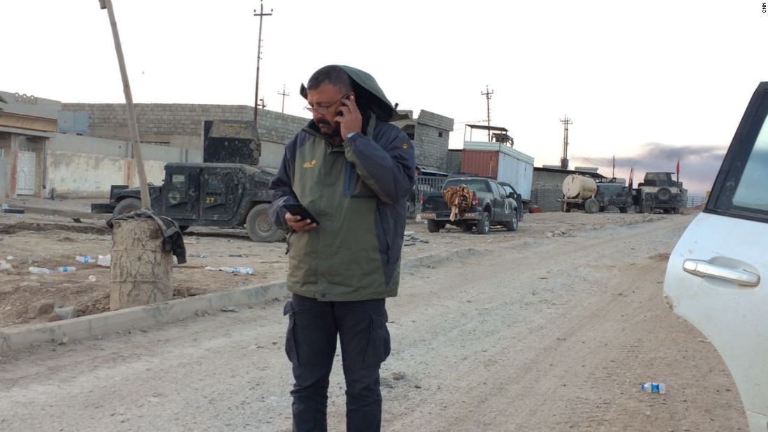 CNN producer Hamdi Alkhshali remained behind the berm, keeping in touch with Arwa and Brice.