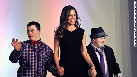 "Oscar winner Hilary Swank walks the runway with two models during the 2016 Global Down Syndrome Foundation ""Be Beautiful, Be Yourself"" fashion show."