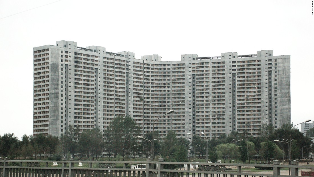 An example of a typical slab-like concrete apartment complex in North Korea, these four apartment towers have been built side by side with a razor thin gap between them.