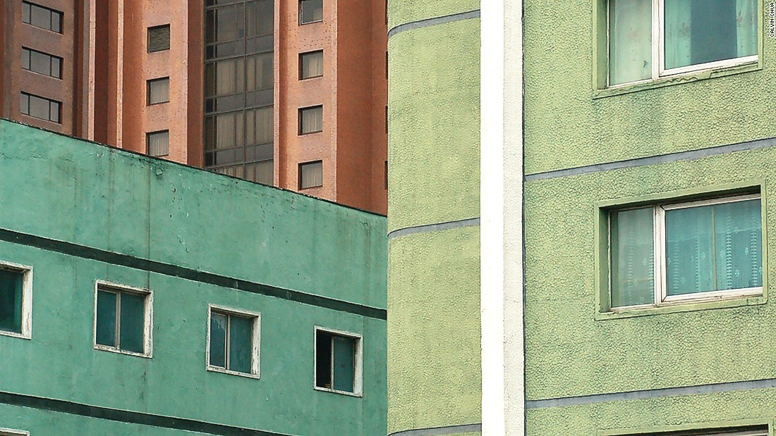 Many buildings in Pyongyang have been painted pasted colors to reduce the blandness of raw concrete.