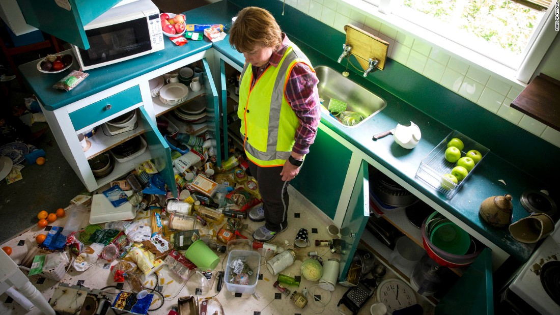Mary Kimber surveys the damage in her kitchen after the quake in Waiau on November 14.