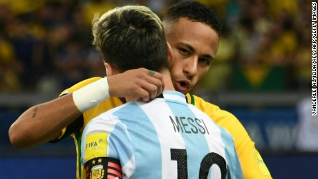 Neymar and Messi embrace after Brazil's 3-0 win over Argentina in Belo Horizone.