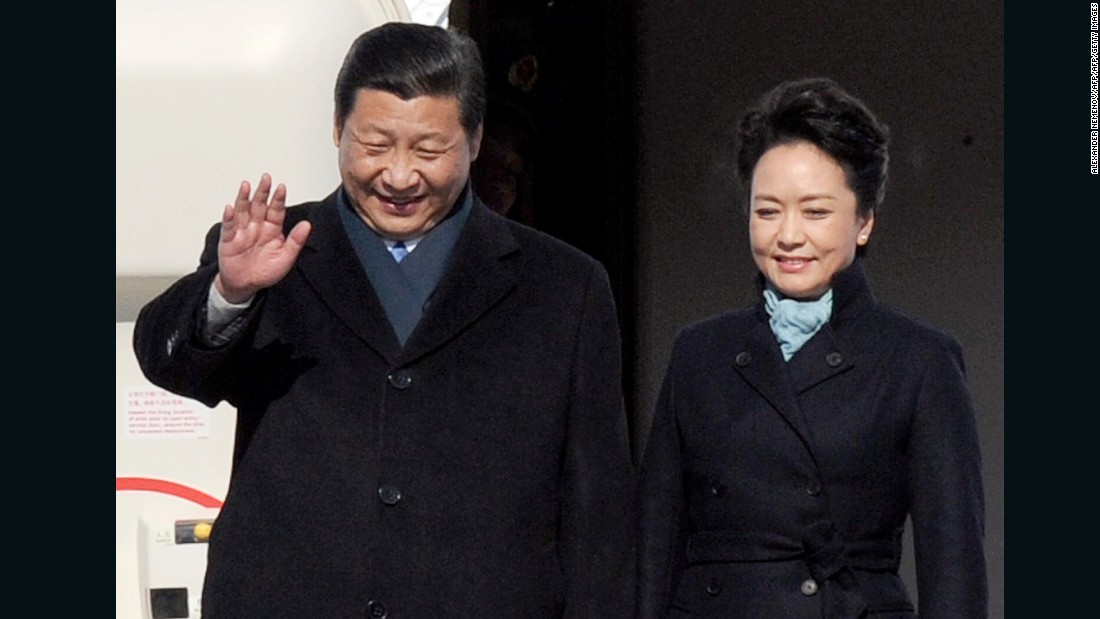"Chinese President Xi Jinping and his wife Peng Liyuan. ""It fits her well, as she is a soldier and she has a kind of assertiveness and toughness,"" Ma says of the now-famous trench coat she designed for China's First Lady."