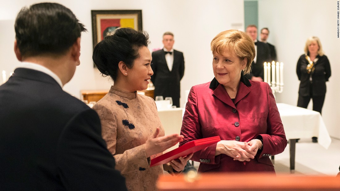 "German Chancellor Angela Merkel speaks with Chinese President Xi Jinping and his wife Peng Liyuan. ""You know sometimes clothing can come across aggressive when it's too revealing and eye-catching and it's the opposite of traditional Chinese aesthetics,"" Ma told CNN."