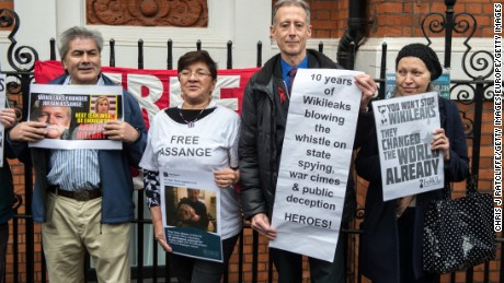 Supporters of Julian Assange gather outside Ecuador's Embassy in London Monday.