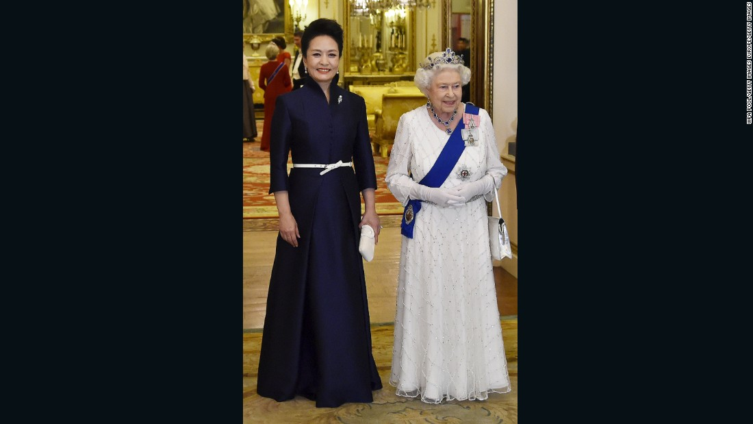"Peng Liyuan, on the left, with Britain's Queen Elizabeth II, arrive for a state banquet at Buckingham Palace in London, England in 2015. ""My philosophy for the First Lady's designs is elegance, subtlety and demureness,"" Ma says."