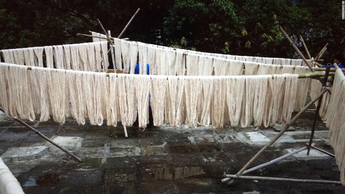 Handmade yarns hanging in the yard of Wuyong studio in Zhuhai.