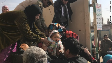 'Running among bullets': Mosul families tell of desperate flight from ISIS