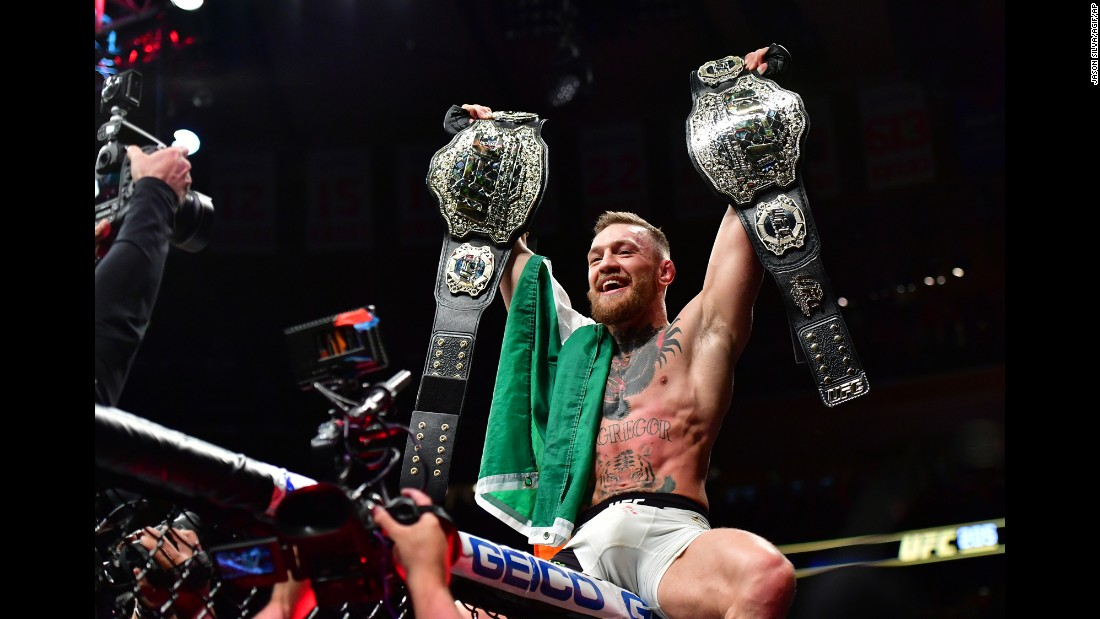 UFC fighter Conor McGregor celebrates with two championship belts after knocking out Eddie Alvarez in New York on Sunday, November 13. McGregor was the featherweight champion coming into the bout, and his victory over Alvarez gave him the lightweight title. He is the first fighter in UFC history to hold two titles simultaneously.