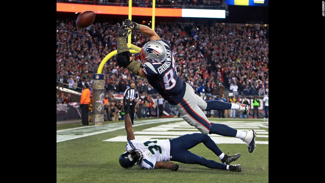 New England tight end Rob Gronkowski can't catch a 4th-and-1 pass late in the NFL game against Seattle on Sunday, November 13. He was defended by Kam Chancellor, bottom, on what was the Patriots' last offensive play of the game. Seattle won 31-24.