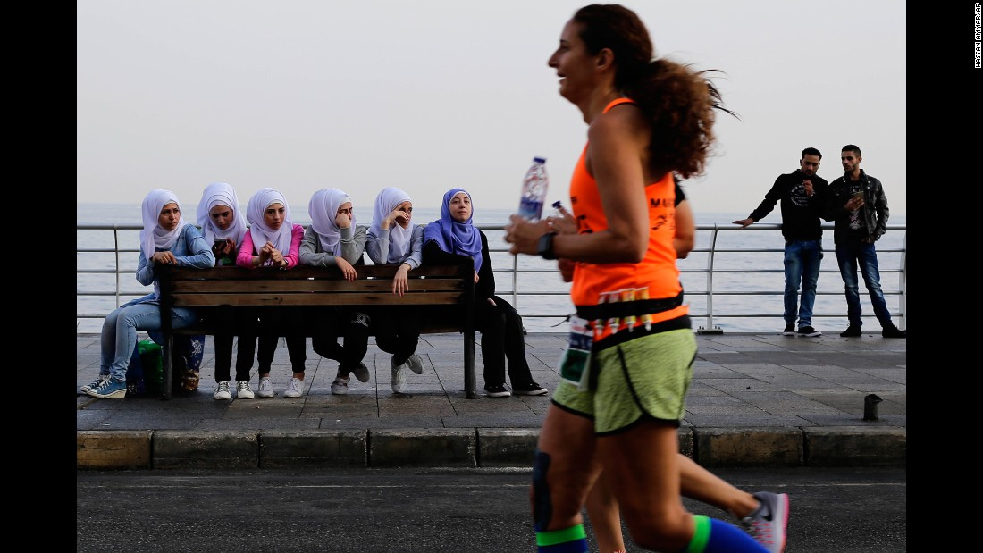 People in Beirut, Lebanon, watch runners compete in the Beirut Marathon on Sunday, November 13.