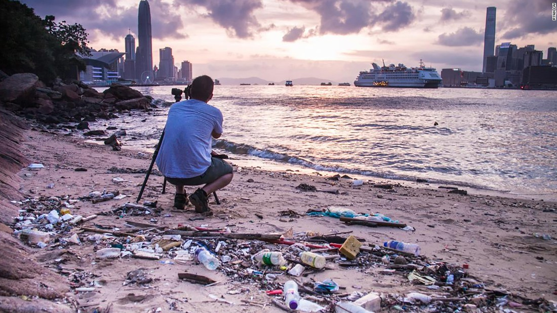 "Photo: Ryan Lai, Hong Kong: ""Piles of solid waste lie behind a perfectly-framed photograph of spectacular scenery."""
