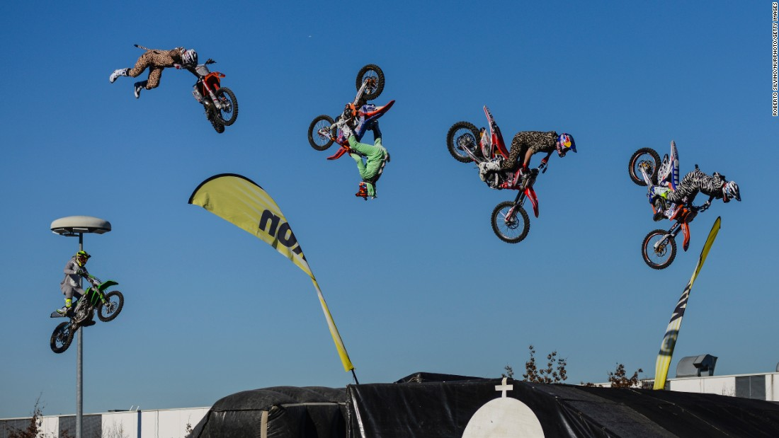 Motocross riders catch some air during the annual Milan Motorcycle Show, which was held in Milan, Italy, from November 8-13.