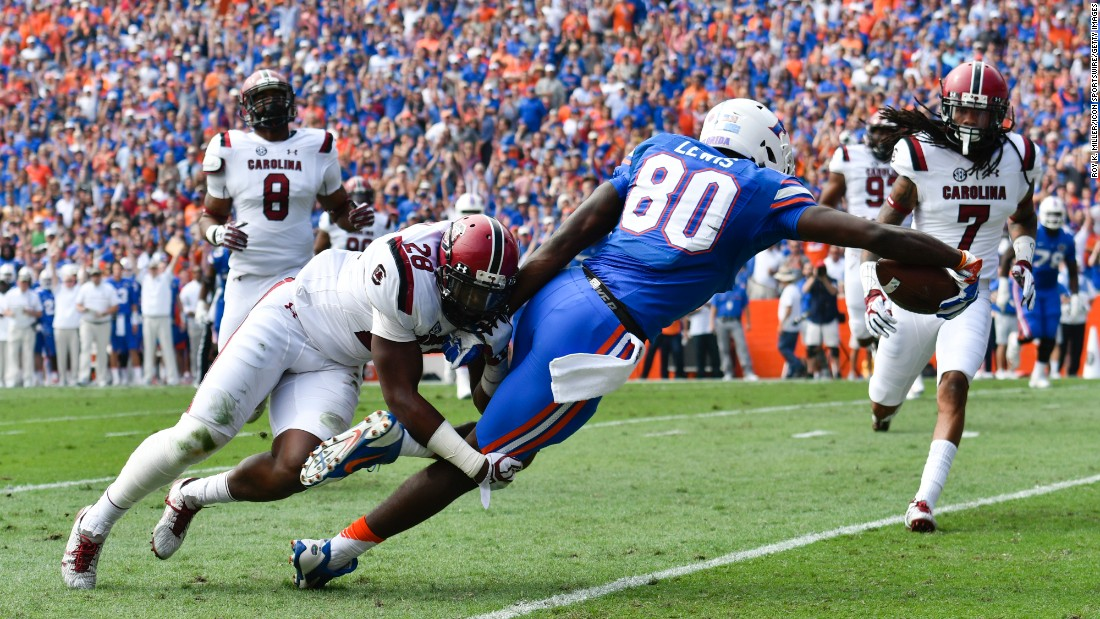 Florida's C'yontai Lewis drags South Carolina's Jonathan Walton into the end zone during a college football game in Gainesville, Florida, on Saturday, November 12. Florida won 20-7 against former head coach Will Muschamp.