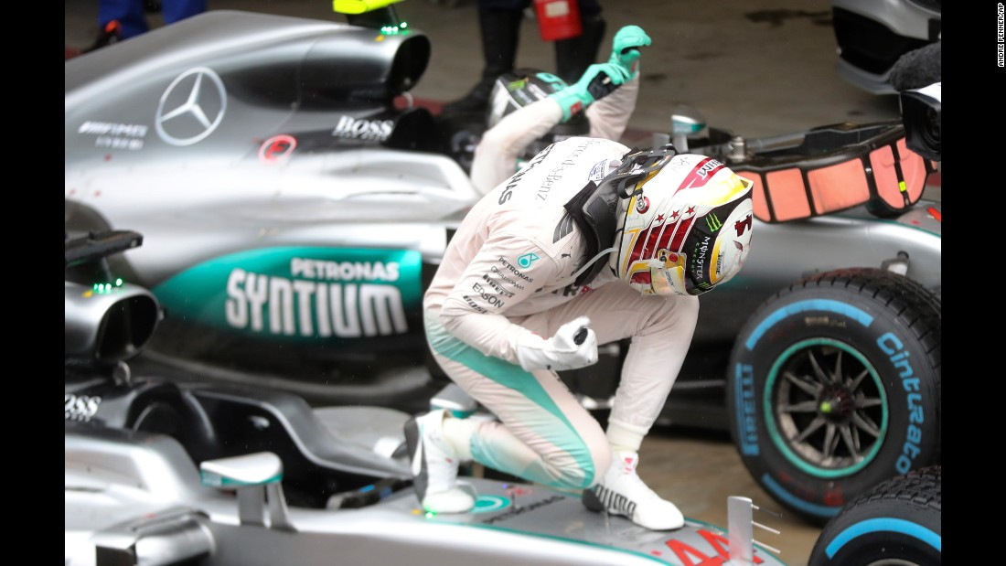 "Formula One driver Lewis Hamilton celebrates on his car after <a href=""http://www.cnn.com/2016/11/13/motorsport/brazilian-gp-rain-hamilton-rosberg/index.html"" target=""_blank"">winning the Brazilian Grand Prix</a> on Sunday, November 13. Last year's champion is now just 12 points behind leader Nico Rosberg going into the final race of the season."