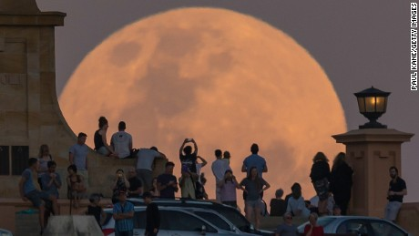 FREMANTLE, AUSTRALIA - NOVEMBER 14: Crowds look on as the super moon rises behind the Fremantle War Memorial at Monument Hill on November 14, 2016 in Fremantle, Australia. A super moon occurs when a full moon passes closes to earth than usual, with the November 14th moon expected to be closer than it has been in over 70 years. (Photo by Paul Kane/Getty Images)