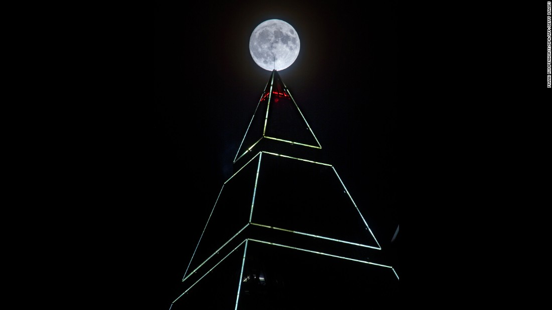 The supermoon appears behind the MesseTurm tower in Frankfurt, Germany, on November 13.