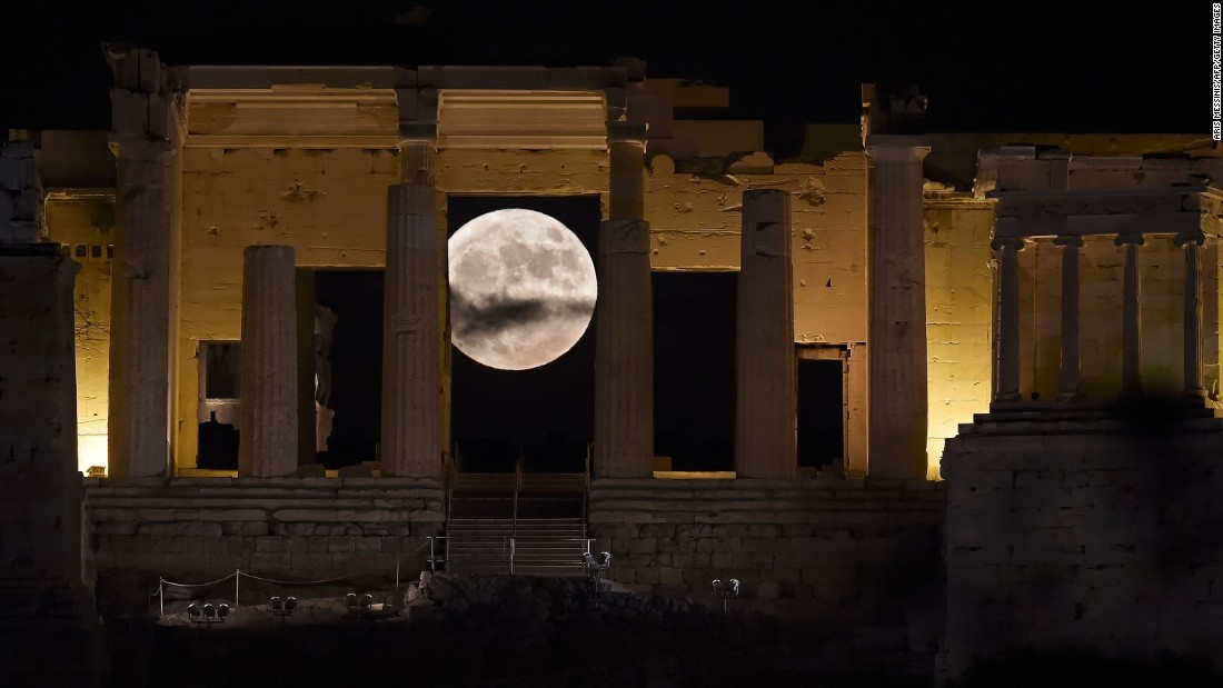 The supermoon rises behind the Propylaea above the Ancient Acropolis hill in Athens, Greece, on November 14.