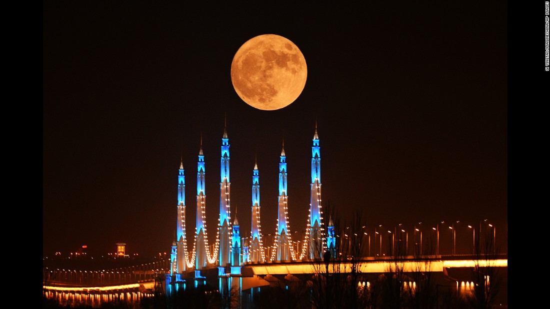 The moon appears over the Binhe Yellow River Bridge in Yinchuan, China, on November 14.
