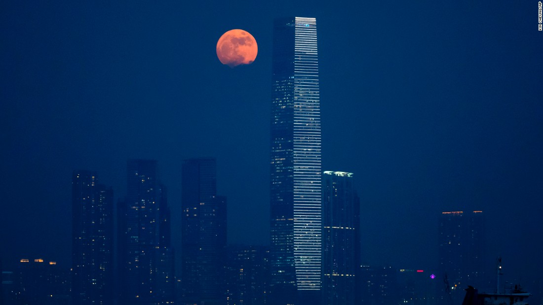 The moon rises over Victoria Harbour in Hong Kong on November 14. A supermoon occurs when the moon becomes full on the same days as its perigee, which is the point in the moon's orbit when it is closest to Earth. Supermoons generally appear to be 14% bigger and 30% brighter than other full moons.
