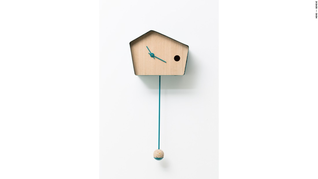The solar-powered Coucou-Nest has a ball of birdseed on its pendulum to attract real birds, who can make their homes inside the clock itself.