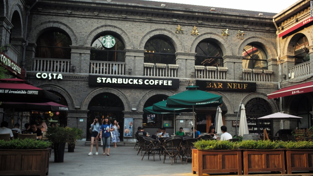 In a commercial and nightlife district next to the palace, named after the year the Republic of China was established, major foreign chains like Starbucks and KFC are housed in historic, gray-brick Republican-era buildings.