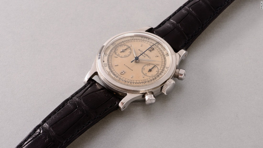 The Patek Philippe reference 1463 is a stainless steel chronograph wristwatch with two tone silvered dial and tachymeter scale.