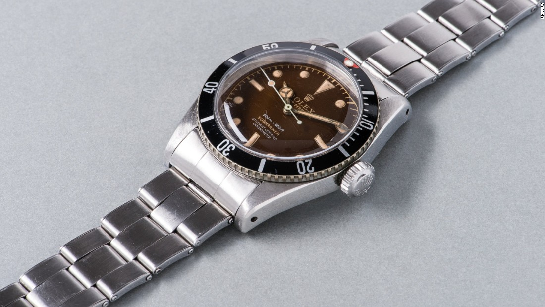 "A stainless steel Rolex wristwatch named ""Big Crown"" was also among the sale's top ten lots. It features a tropical brown ""four liner"" dial and bracelet and sold for $567,620 (CHF 562,000)."