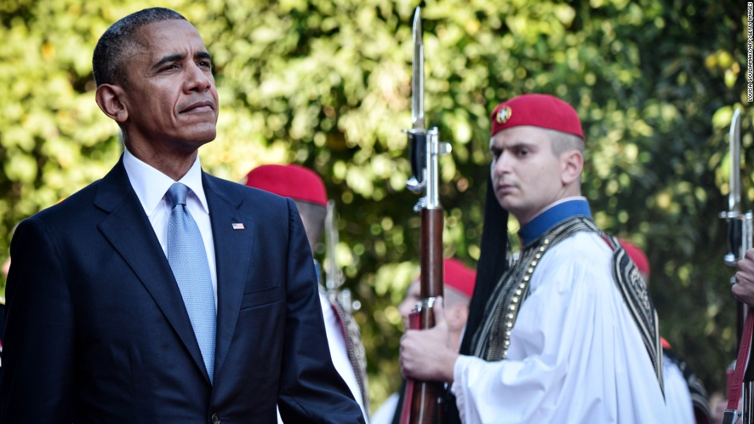 Obama reviews a presidential honor guard during an official welcoming ceremony in Athens on November 15.