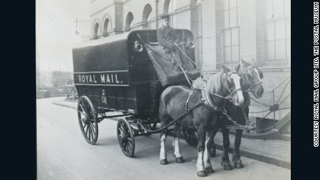 Royal Mail horse-drawn mail coach c.1910.