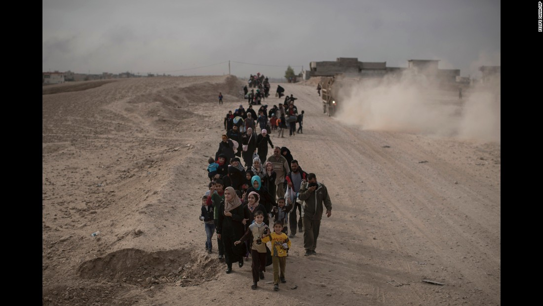 People flee the fighting in the Mosul area on Tuesday, November 15.