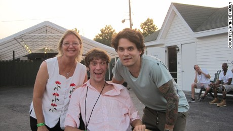 "Anner poses with mother Susan Anner and singer John Mayer, who wrote the theme song to his TV show, ""Rollin' with Zach."""