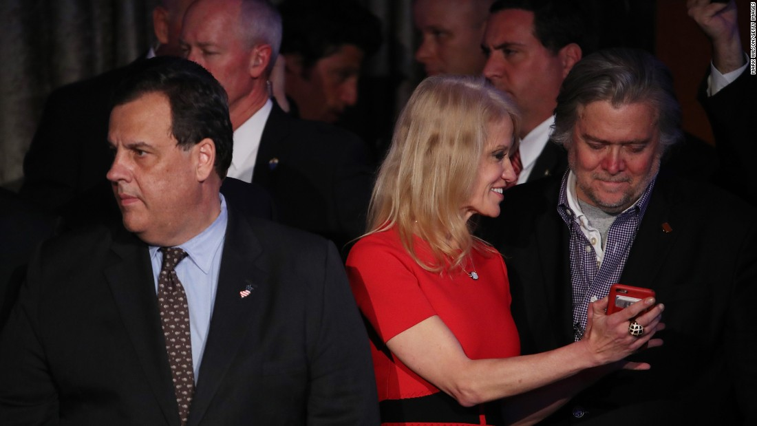 New Jersey Gov. Chris Christie, left, stands on stage with Bannon and Trump campaign manager Kellyanne Conway during Trump's election night event in New York.
