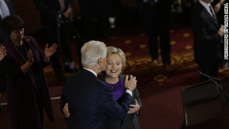 Former President Bill Clinton kisses his wife after she delivers her concession speech to Trump.