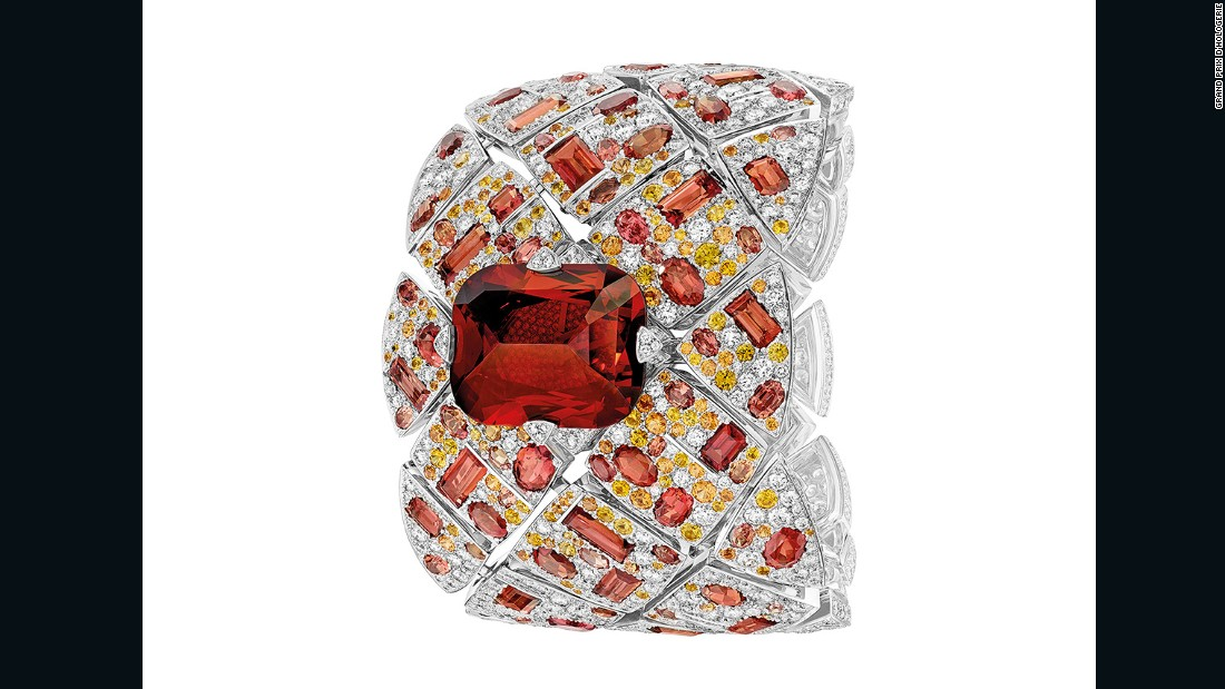 "Chanel took home the Jewellery Watch Prize at the 2016 GPHG awards ceremony for its spectacular, single-edition Secret Watch ""Signature Grenat"". The 18-carat white gold watch sells for more than $750,000, and features a 52.61 carat carmine garnet surrounded by diamonds and orange sapphires."