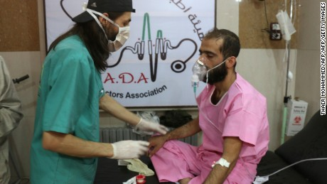"""A doctor treats a Syrian man suffering from breathing difficulties at a make-shift hospital in Aleppo after regime helicopters dropped barrel bombs on the rebel-held Sukkari neighbourhood of the northern Syrian city on September 6, 2016.  The Britain-based Syrian Observatory for Human Rights said the bombs hit the Sukkari neighbourhood and that more than 70 people """"most of them civilians"""" were treated for choking symptoms.  / AFP / THAER MOHAMMED        (Photo credit should read THAER MOHAMMED/AFP/Getty Images)"""