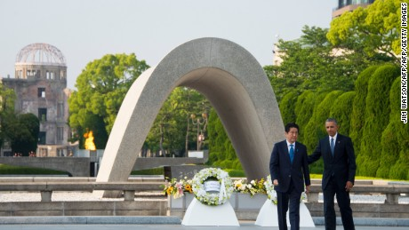 Barack Obama and Japanese Prime Minister Shinzo Abe turn around after laying wreaths to commemorate the victims of the world's first nuclear attacks during a visit to the Hiroshima Peace Memorial Park on May 27, 2016.