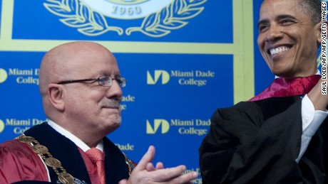 US President Barack Obama receives as Associate Degree of Science alongside Eduardo Padron (L), president of Miami Dade College, after delivering the commencement address during Miami Dade College graduation ceremonies at the James L. Knight International Center in Miami, Florida, April 29, 2011. AFP PHOTO / Saul LOEB (Photo credit should read SAUL LOEB/AFP/Getty Images)