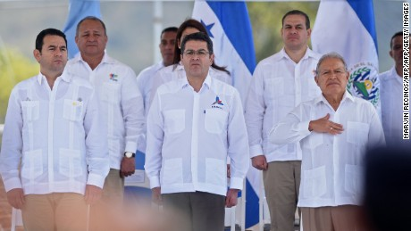 (L-R) Guatemala's President Jimmy Morales, Honduras' President Juan Orlando Hernandez and El Salvador's President Salvador Sanchez Ceren attend the official launch of the Trinational Force against organized crime in Nueva Ocotepeque, Honduras on November 15, 2016.  The Trinational Force is formed by soldiers and police of Honduras, El Salvador and Guatemala with the objective of fighting crime affecting the Central America's Northern Triangle. / AFP / Marvin RECINOS        (Photo credit should read MARVIN RECINOS/AFP/Getty Images)
