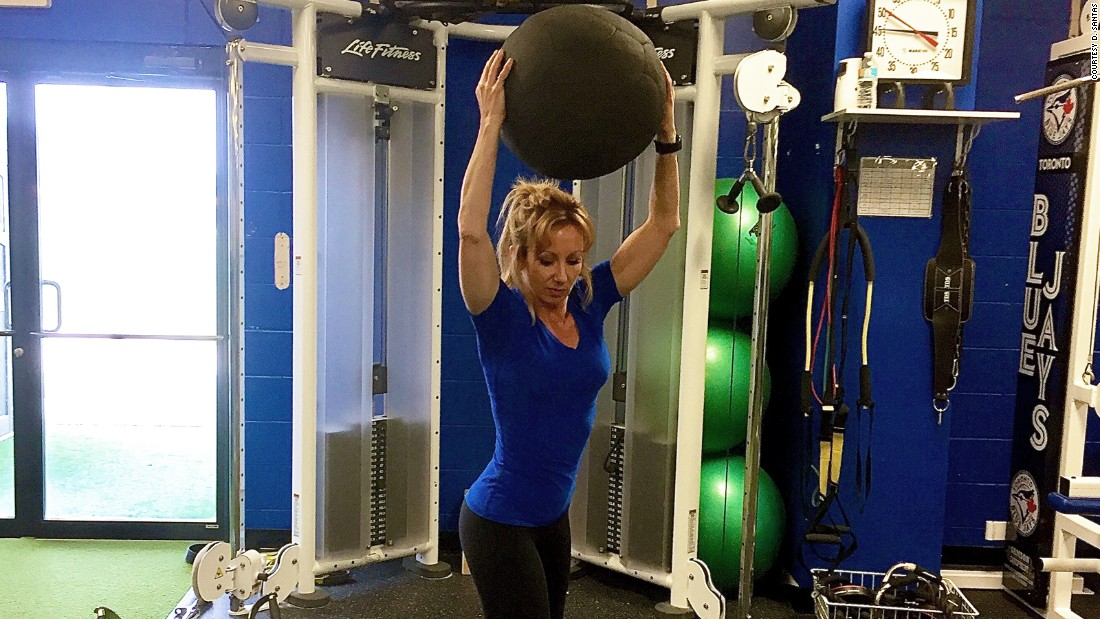 Slamming medicine balls serves as a core-focused total-body exercise. Slams can be done from standing, kneeling or half-kneeling stances. Dana Santas demonstrates her favorite version of standing, rotational slams.