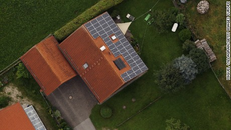 PEITING, GERMANY - AUGUST 11:  Aerial view shows photovoltaic panels on the roof of a bulding on August 11, 2010 near Peiting, Germany. German politicians are debating the future of the government's subsidies for solar energy investments, with the federal government seeking to cut its current subsidies by between 11 and 16 percent, while local governments in Germany's Laender, especially in eastern Germany, want cuts capped at 10 percent. Germany is investing heavily in alternative energies.  (Photo by Miguel Villagran/Getty Images)