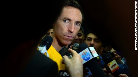 Steve Nash of the NBA's Los Angeles Lakers takes questions while surrounded by the press on media day in El Segundo, California on September 29, 2014. The Los Angeles Lakers will open their season on October 29 against the Houston Rockets. AFP PHOTO / Frederic J. BROWN        (Photo credit should read FREDERIC J. BROWN/AFP/Getty Images)