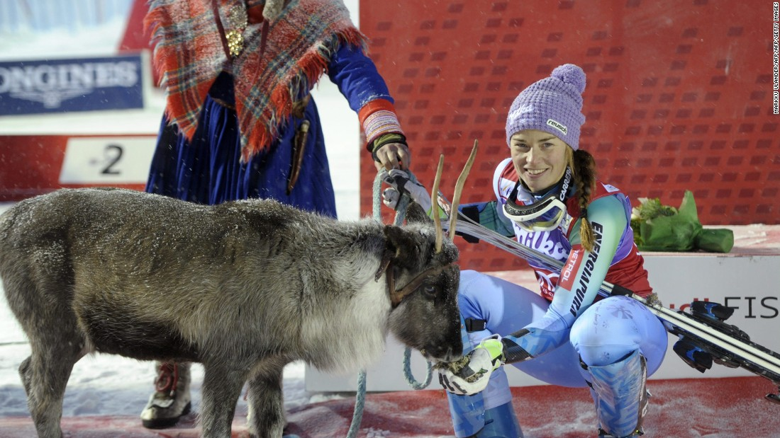 Slovenia's Tina Maze meets her reindeer, Viktor, after winning in 2014. Maze retired from professional skiing earlier this season.