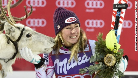 "Mikaela Shiffrin of the US poses with a white reindeer named ""Mikaela"" she was given after winning the Ladies' FIS Alpine Skiing World Cup slalom race in Levi Kittilä, Finland on November 12, 2016. / AFP / Lehtikuva / Martti Kainulainen / Finland OUT        (Photo credit should read MARTTI KAINULAINEN/AFP/Getty Images)"